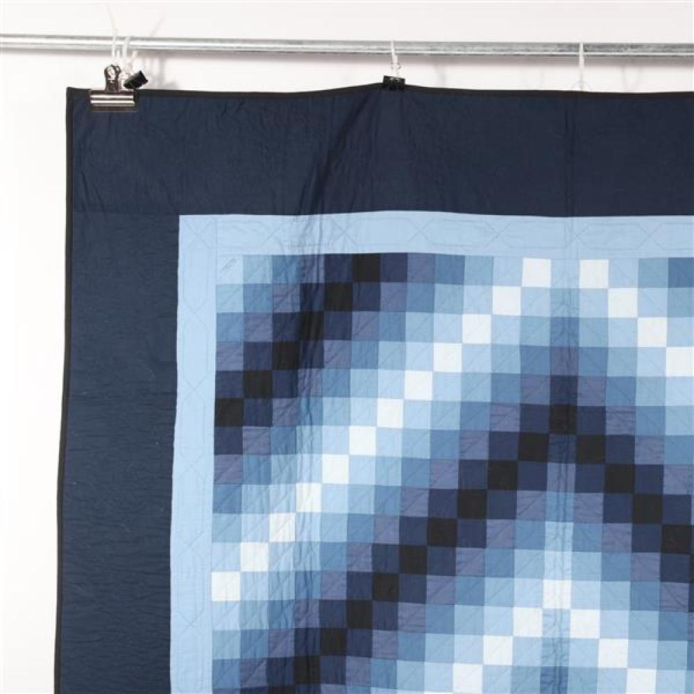 Pennsylvania Amish Trip Around the World quilt in shades of blue.