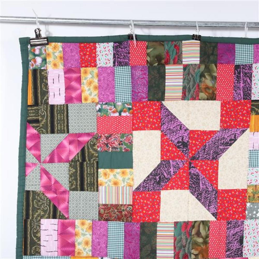 Tutwiler Mississippi African American quilt with pinwheel design, quilted by Susan Rogers.