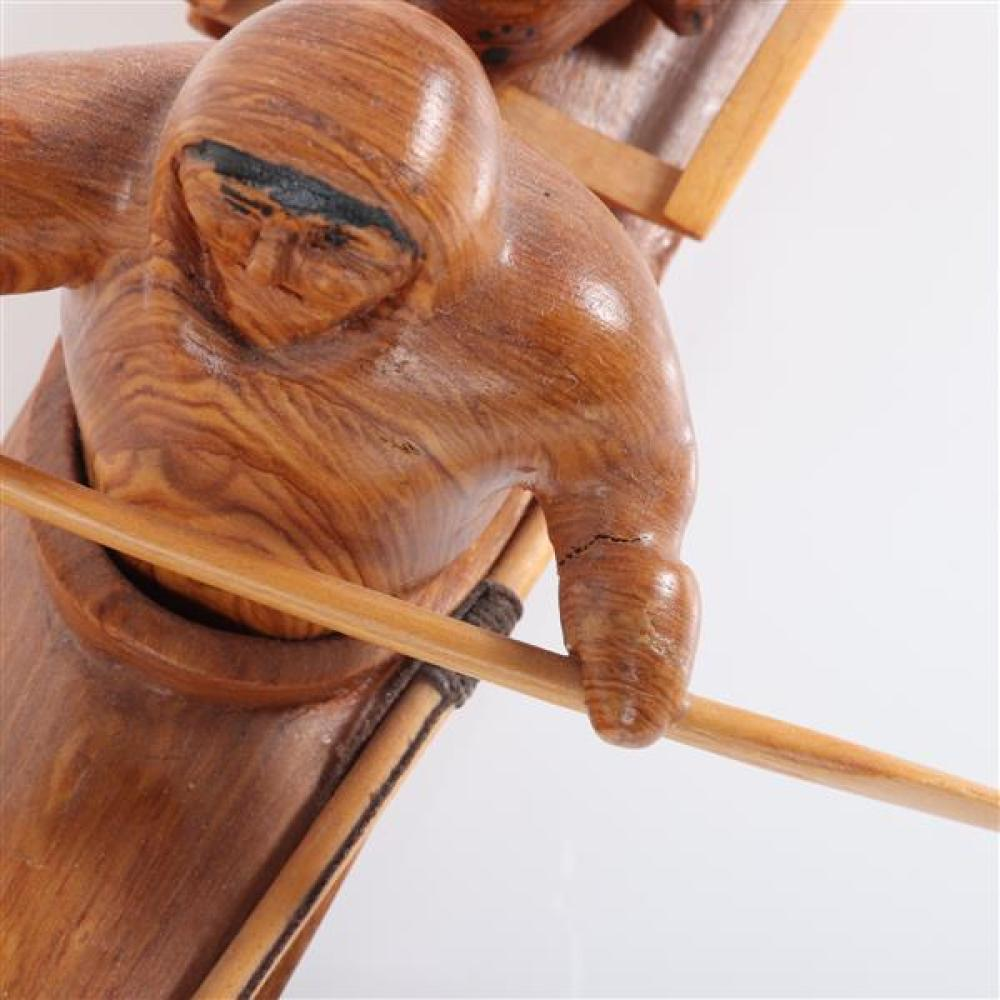 Roy Dimmick Deering, Alaska Eskimo / Inuit carved wood model of a kayak with hunter and seal dated '93.
