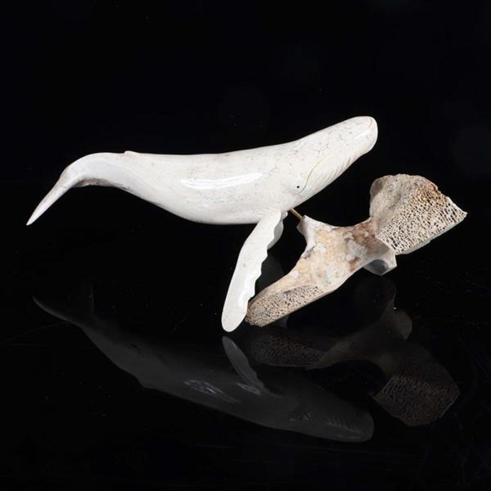 Humpback whale figure carving by 'Baer' Richard Middleton. Fossilized walrus jaw bone, baleen, and whale vertebrae stand.