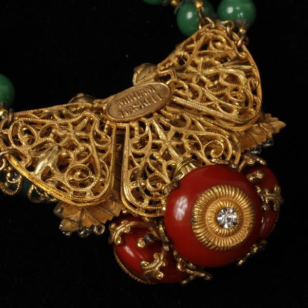 "Miriam Haskell multi strand green and red glass bead and rhinestone ""butterfly"" necklace with floral clasp."