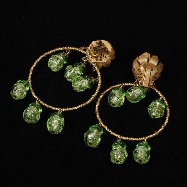 Miriam Haskell chandelier clip earrings with gold tone beaded hoops and green poured glass dangle beads.