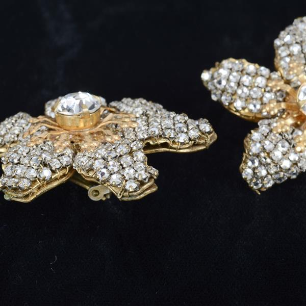 Miriam Haskell 2pc.; grey pearl multistrand bracelet and jewel encrusted flower earrings.
