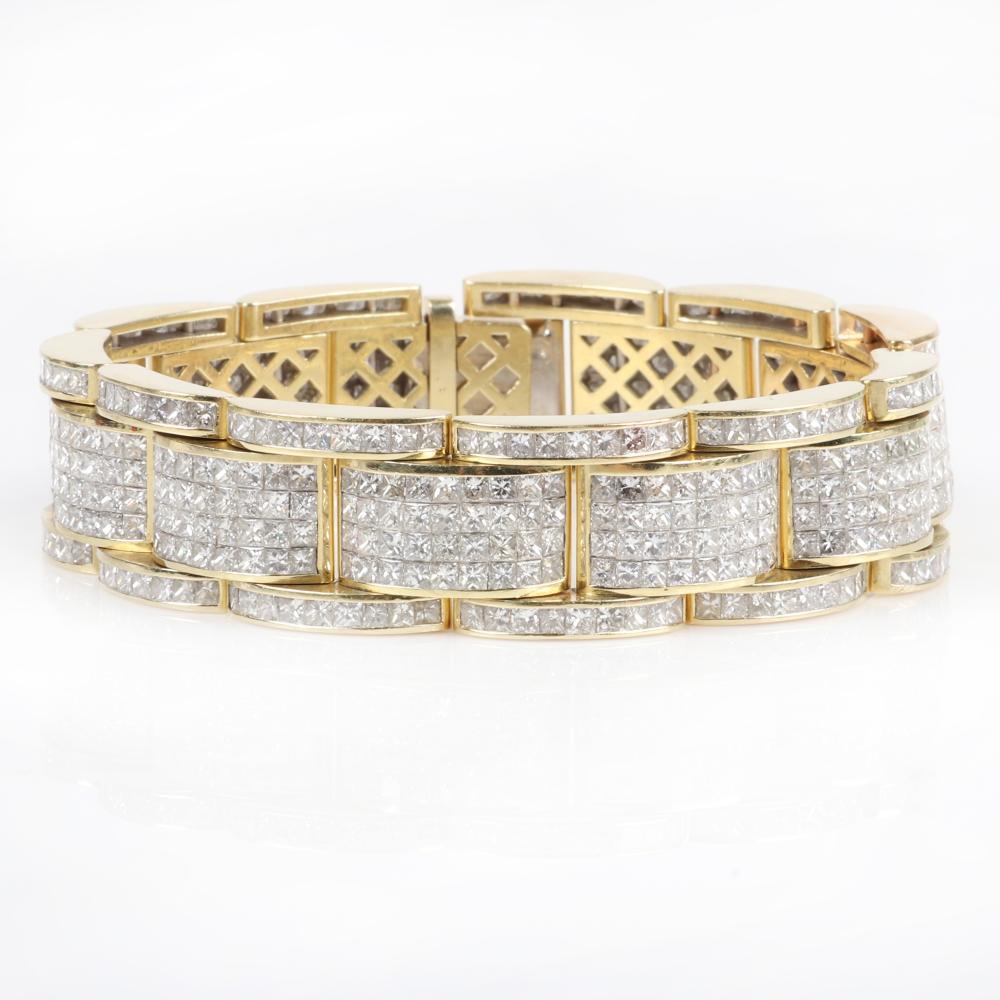 "Men's Designer 18K yellow gold invisibly set diamond encrusted tank link bracelet, 81.15dwt. 8 1/2""L, 3/4""W"