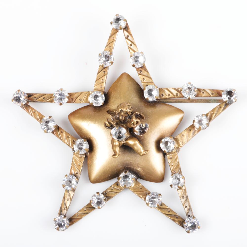 "Joseff of Hollywood star brooch with cherub holding dangling rhinestones 3""H x 3""W"