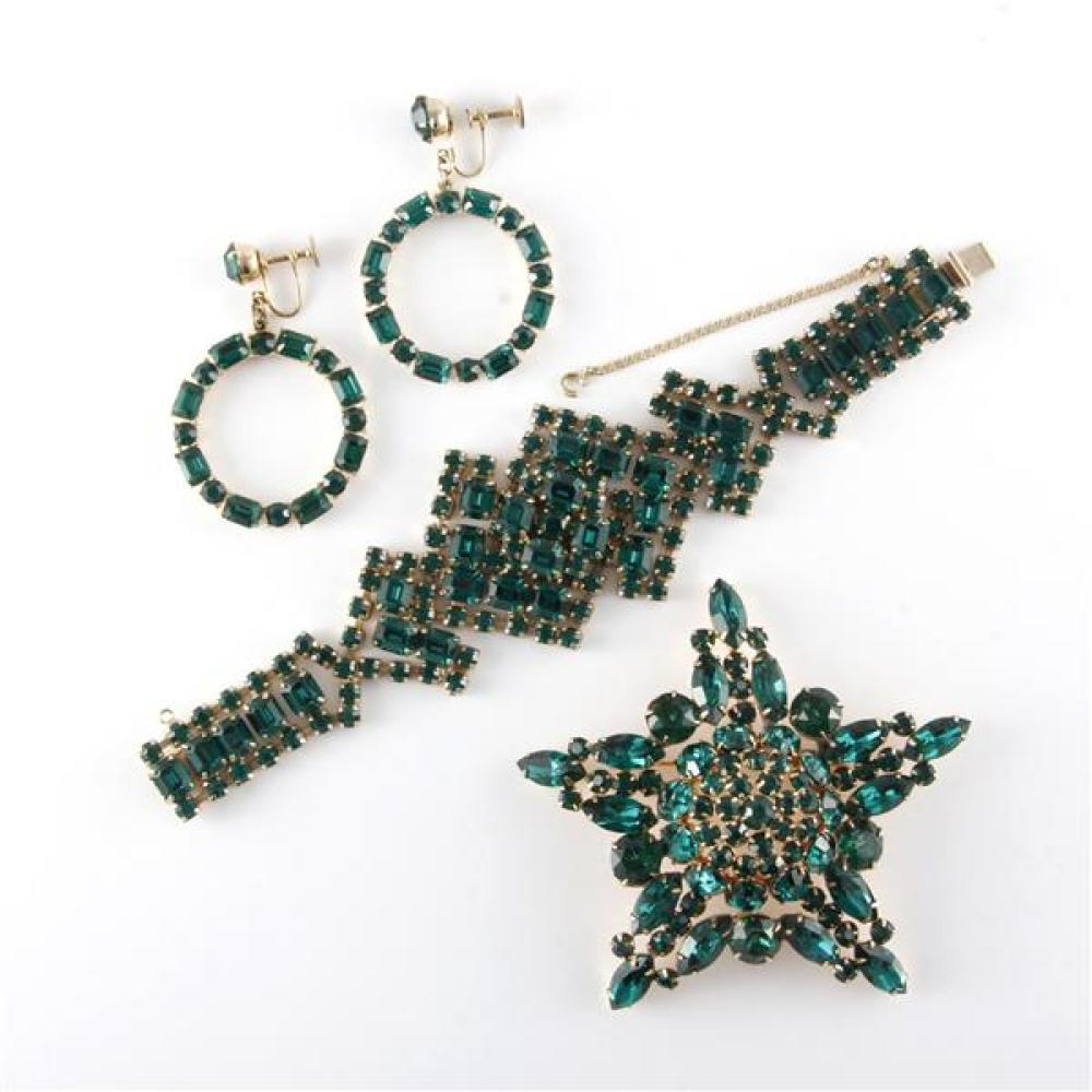 Weiss emerald color jeweled bracelet paired with Coro jeweled drop hoop earrings and unsigned rhinestone star shaped domed brooch.