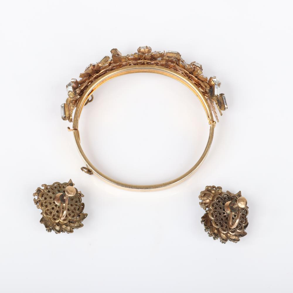 """Miriam Haskell bangle bracelet encrusted with baguette flowers and rhinestones with floral earrings with large central blue rhinestones. 2 1/4"""" inner diam (bracelet)"""