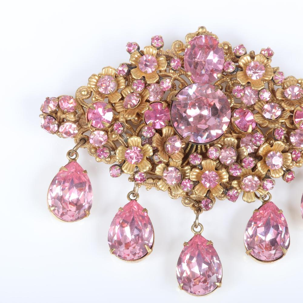 """Miriam Haskell large pin from the private collection of Sanford Moss with layers of bras flowers and heavily faceted rhinestones and dangling pink teardrop crystals. 2 1/2"""" x 3 1/4"""""""