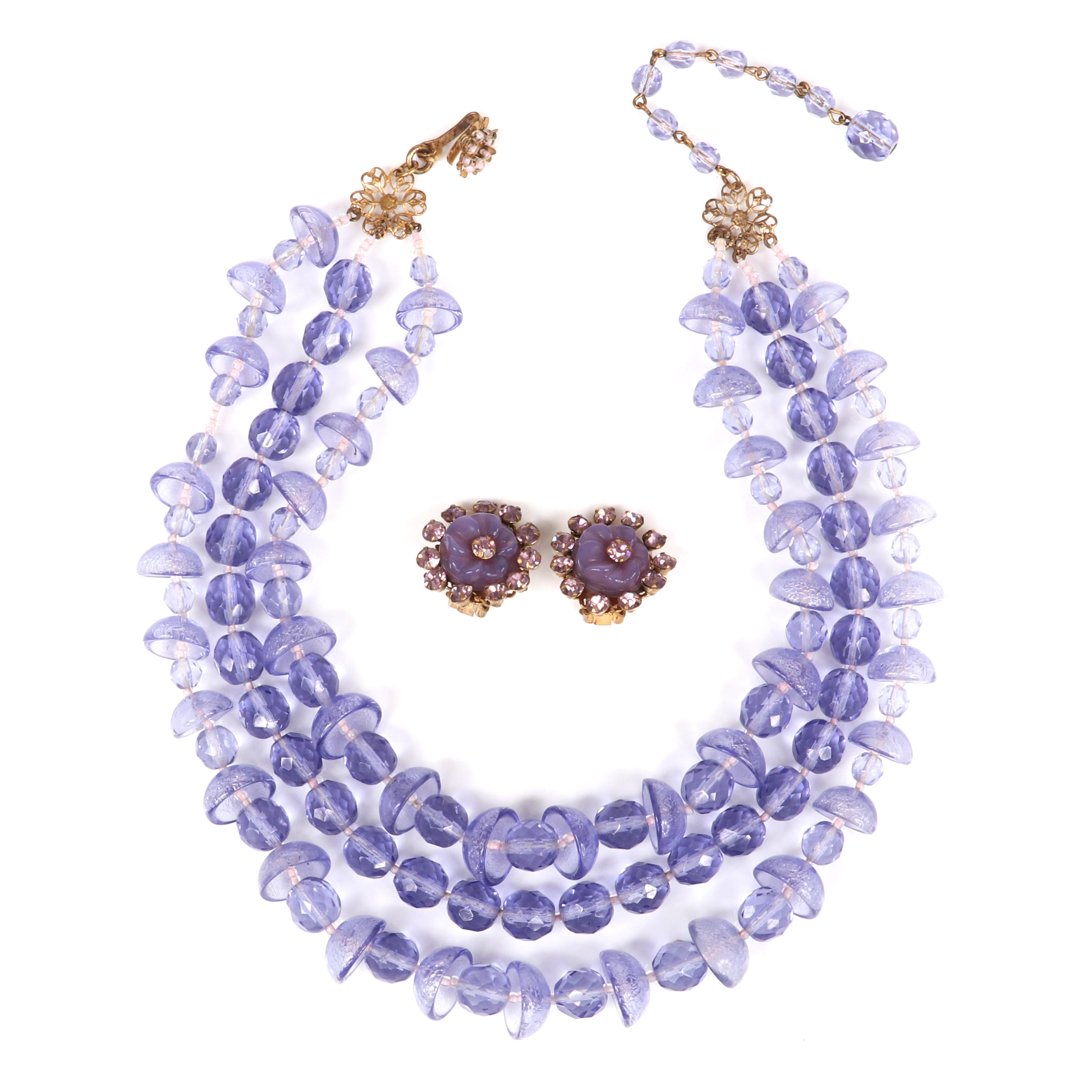 """Miriam Haskell triple strand necklace with amethyst glass faceted and cup shaped beads with purple rhinestone and molded glass flower earrings. 17""""L"""