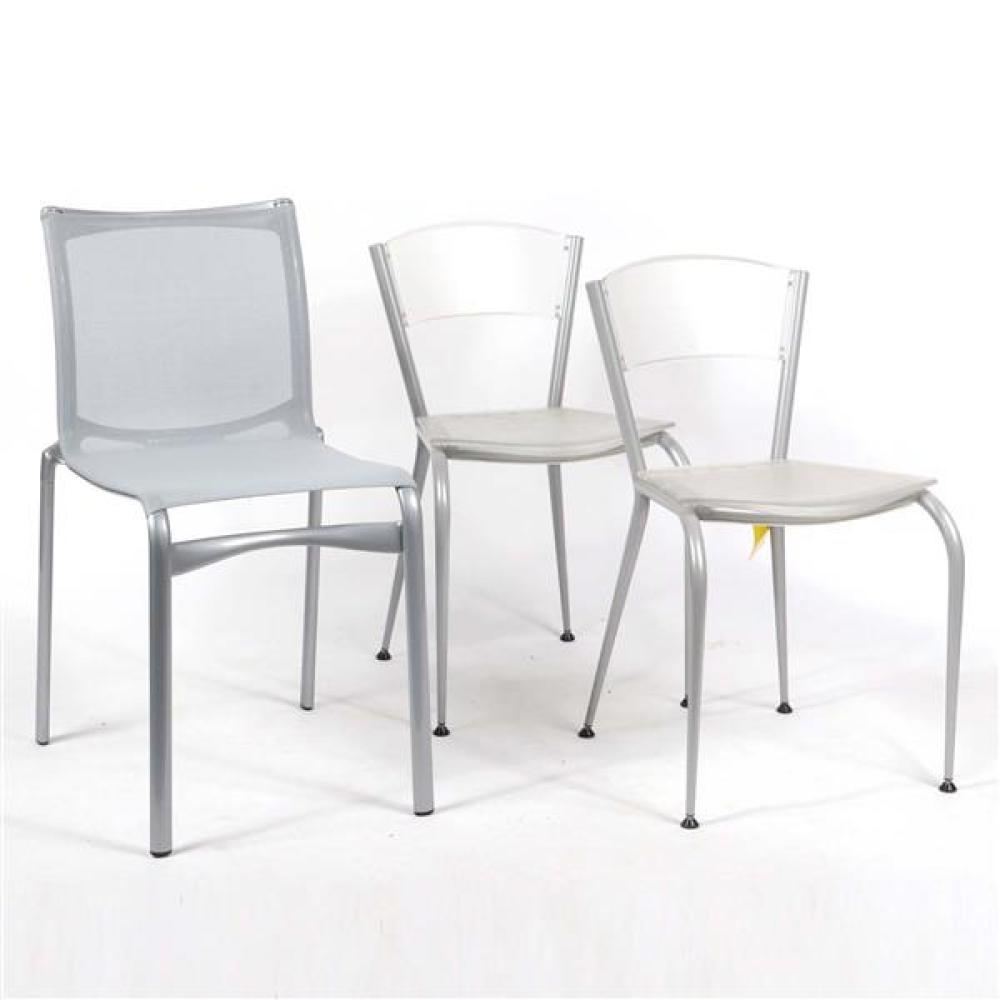 """Three modern stackable chairs; pair Baleri Italia 'MiMi' clear plastic dining chairs designed by Enrico Baleri, and Alias 'Big Frame 441' mesh side chair in nickel silver. 32""""H x 17""""W x 18""""D (one)."""