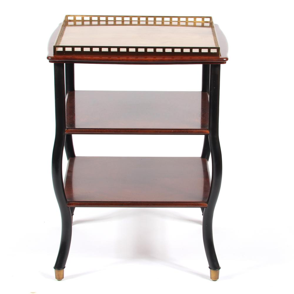 """Two tier designer occasional table with ebony serpentine legs, burlwood stretcher shelves and brass top with pierced gallery. 30""""H x 21""""W x 22""""D."""