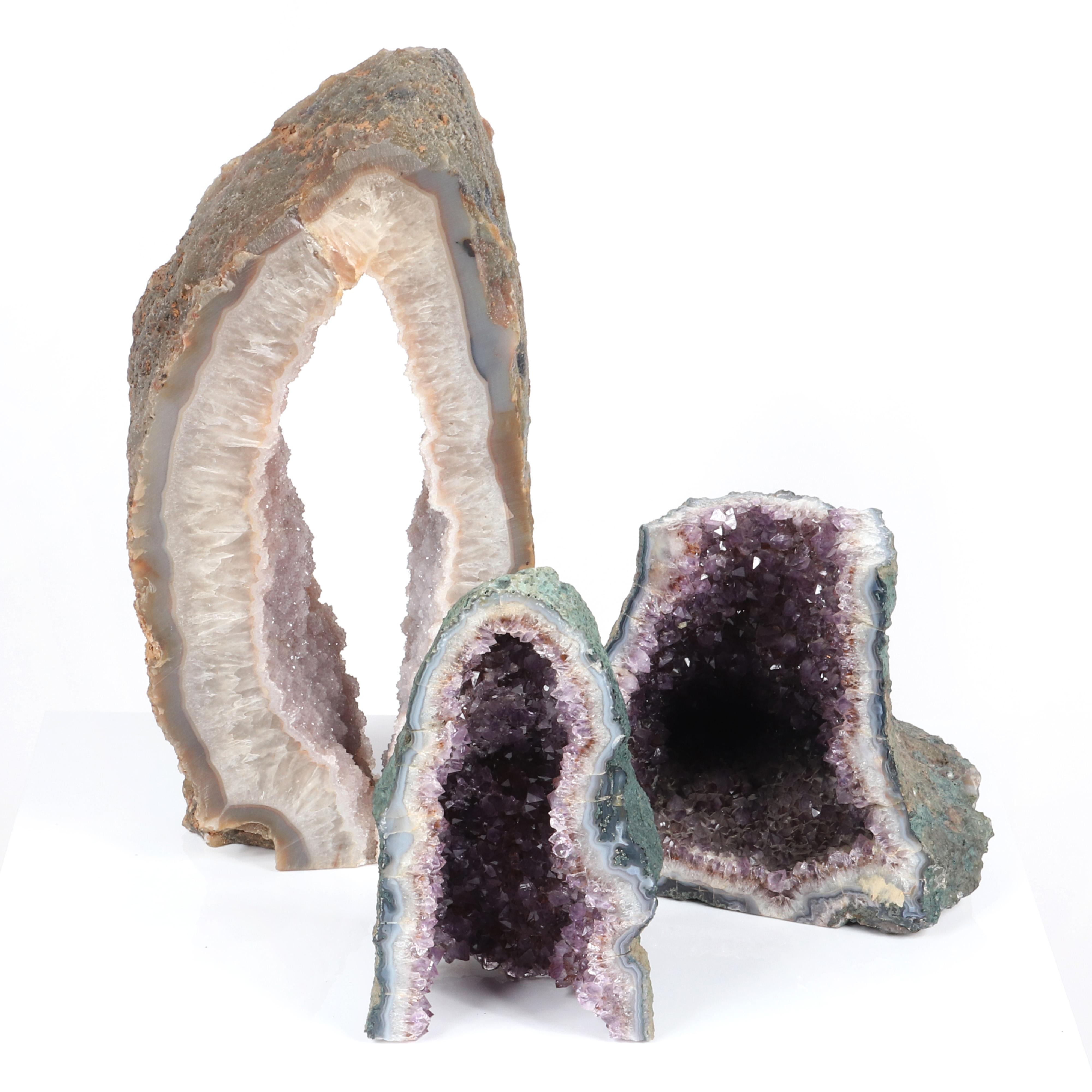 """Three natural rock crystal cathedral amethyst specimens. 18""""H x 9 1/2""""W (tallest)."""