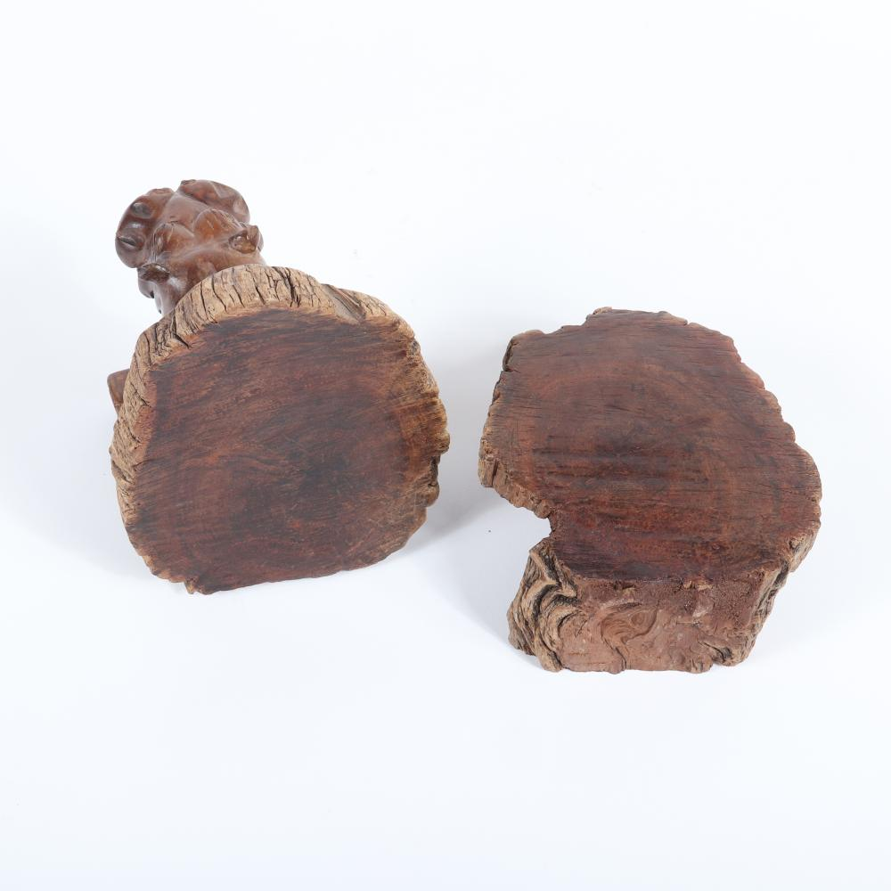 """Pair African hand carved natural wood bookends in the form of a 3 dimensional rhinoceros front and back along with a leather covered animal figure. 7""""H x 6""""W x 5 1/2""""D (one bookend)."""