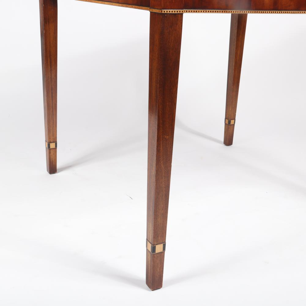 Handmade by Trosby Furniture of Sussex England; Games Table with reversible top, inlaid with ebony and rosewood, The Chess and Backgammon boards are inlaid with ebony and yewwood, two working drawers, square tapered l...