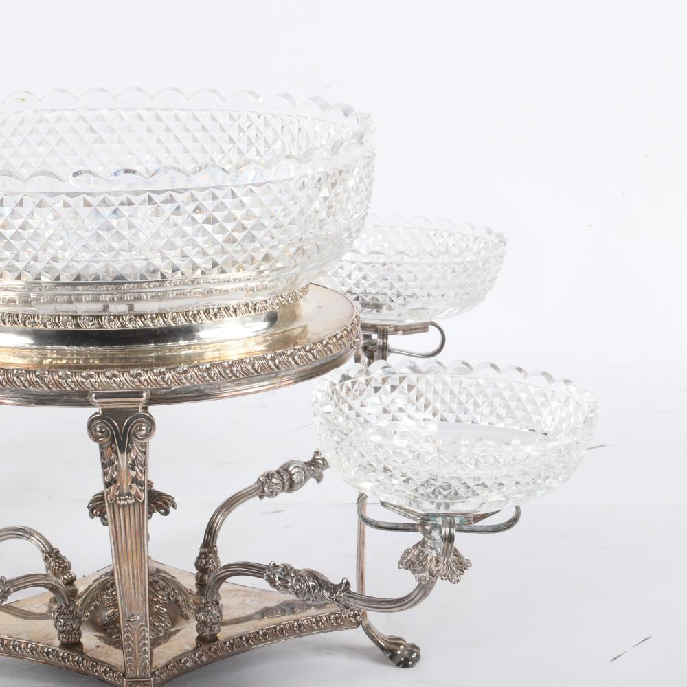 Georgian Sheffield silver plated four branch epergne with five lead crystal bowls, England c.1815. 9 inches in height, without the bowl. 11 1/2 inches in width, and 8 1/2 inches in depth.