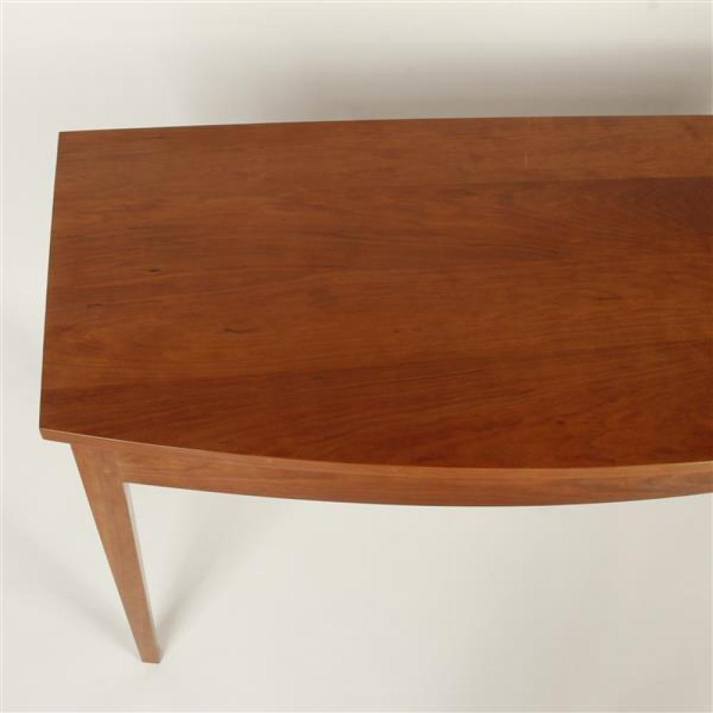 """Thos. Moser Handmade American Furniture, Maine; cabinet made Shaker style bowfront console entry table and mirror in cherry hardwood. Table; 28H""""H x 54""""W x 20""""deepest. Mirror; 32"""" x 24""""."""