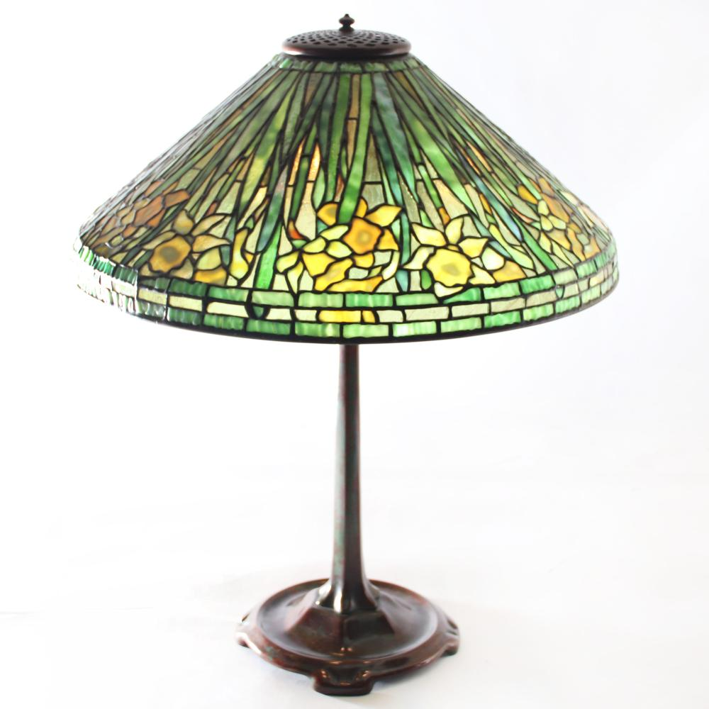 "Tiffany Studios, New York Daffodil leaded glass shade table lamp on bronze base. 24 1/2""H (with finial and shade), 21""diam (shade)."
