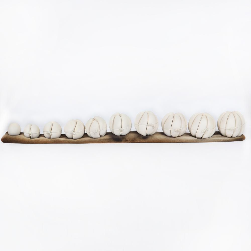 "Brad Miller, (American, b.1950), Enclosure Compression Forms (10), 1981, porcelain sculpture, 5 1/4""H x 4 1/2""D, largest piece, 45""W."