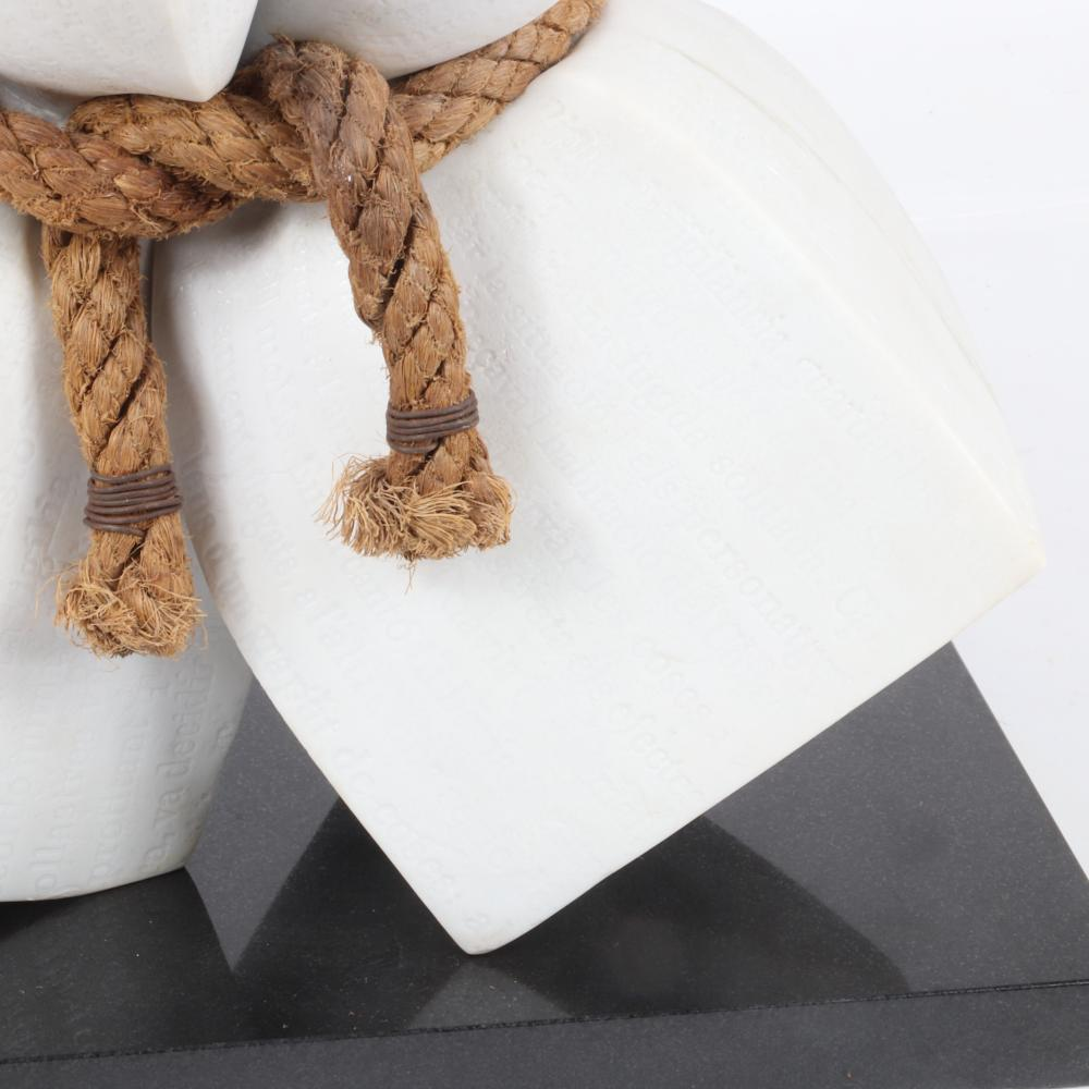 "Lluis Cera, (Spanish, b.1967), What I Didn't Tell You, 2003, carrara marble and rope sculpture on black granite plinth, with allover literary carving in Italian prose in the stone, 17""H x 18""W x 10""D, all excluding th..."