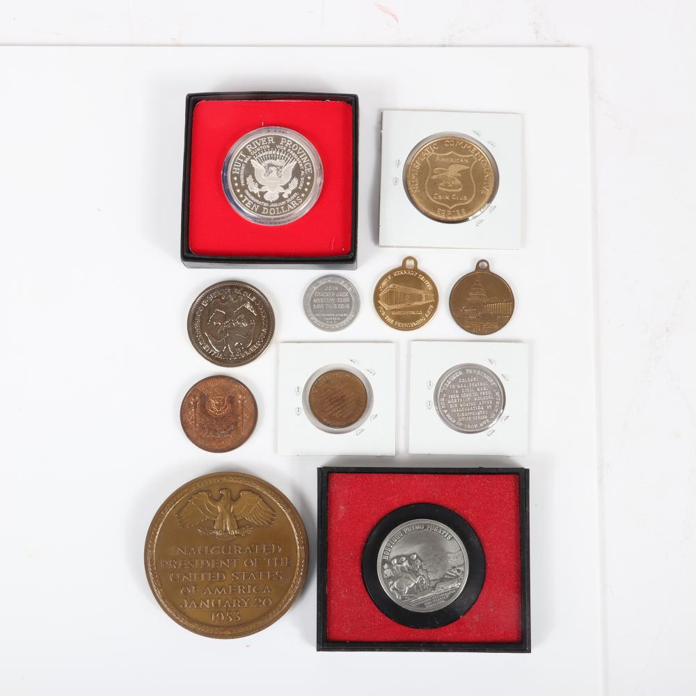 """Eleven Presidential commemorative coins and medals: large bronze Eisenhower 1953 inaugural medal, Clinton 1993 inaugural coin in box, George Washington America's First Medal 2 3/4""""diam (Eisenhower bronze)"""