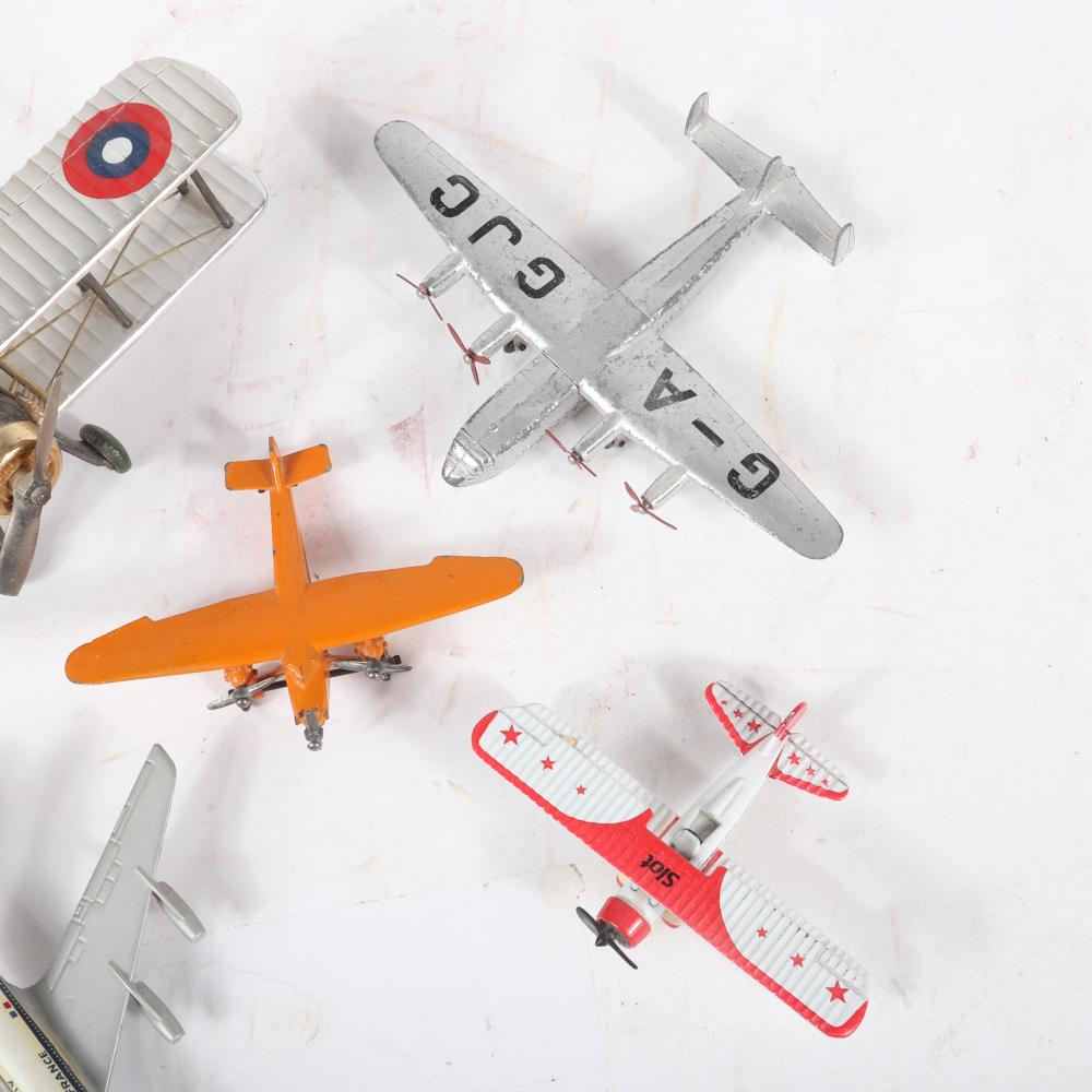 """Five toy airplanes including G-A GJC Dinky Toy, Stearman Squadron 1:72, CIJ Boeing 707 Air France and two prop planes. 2""""H x 6 1/2""""W x 8""""D"""