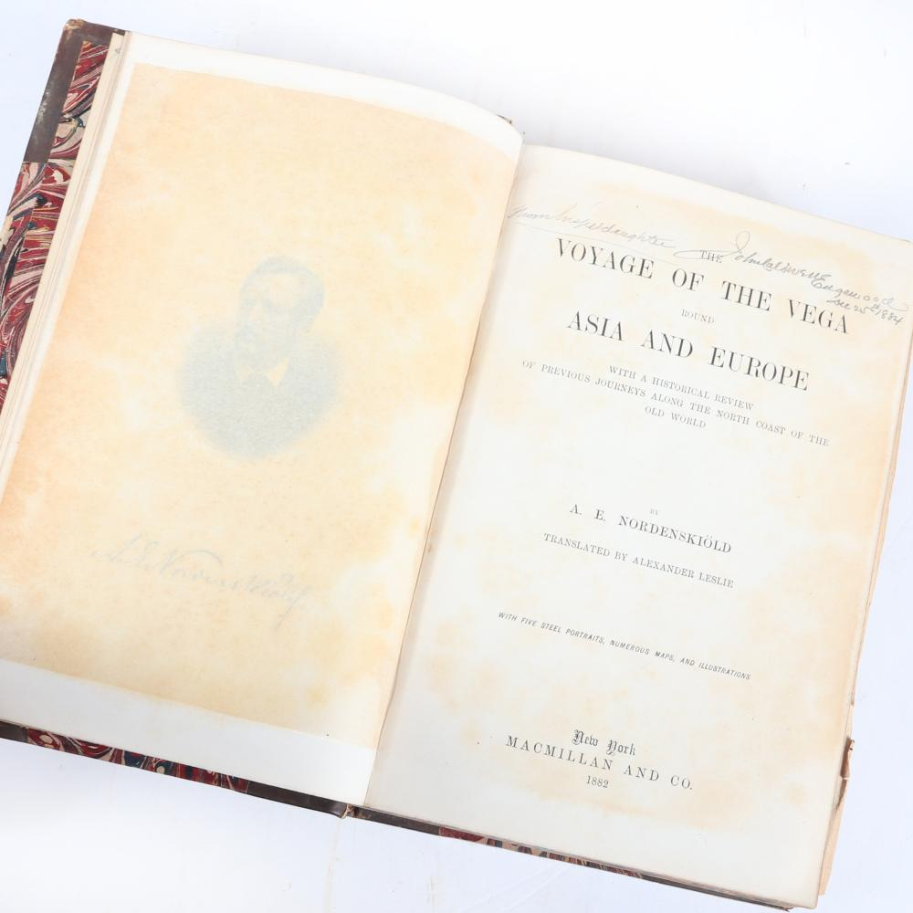 """Seven antique books: A.E. Nordenskiold """"The Voyage of the Vega Round Asia and Europe,"""" 1882, 4 steel-engraved plates, 10 lithographed folding maps, 298 woodcut illustrations. 2""""H x 6""""W x 9""""D (Vega)"""