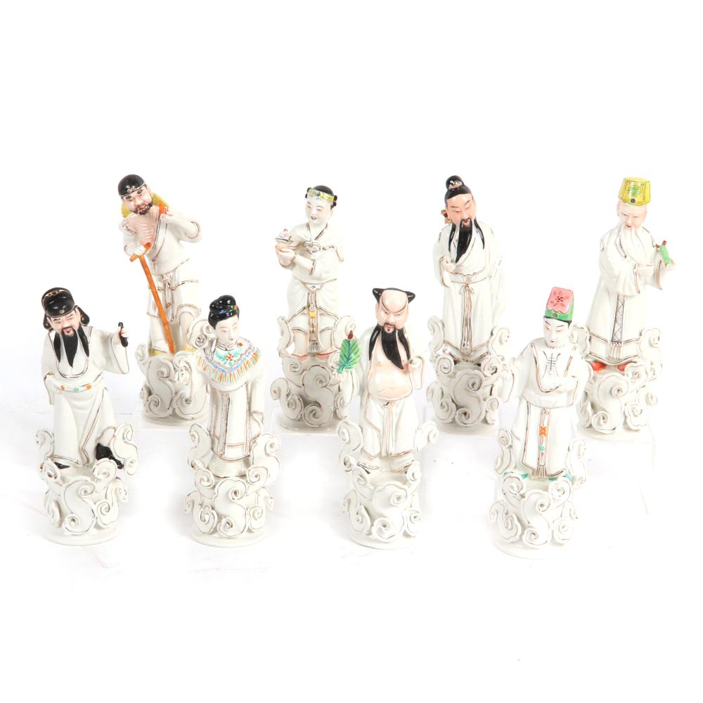 """Eight Chinese white porcelain Immortals figurines with gilt and painted details. 10 1/2""""H"""