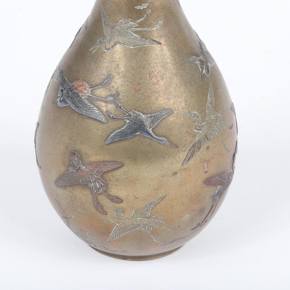 "Japanese Meiji mixed metal bronze gourd form vase decorated with silver and copper, inlaid and incised senbazuru (thousand cranes), Made by Suke Yoshibumi of Hemada Studio, ca. 1850. 10 3/4""H, 3 3/8""W (at widest)"