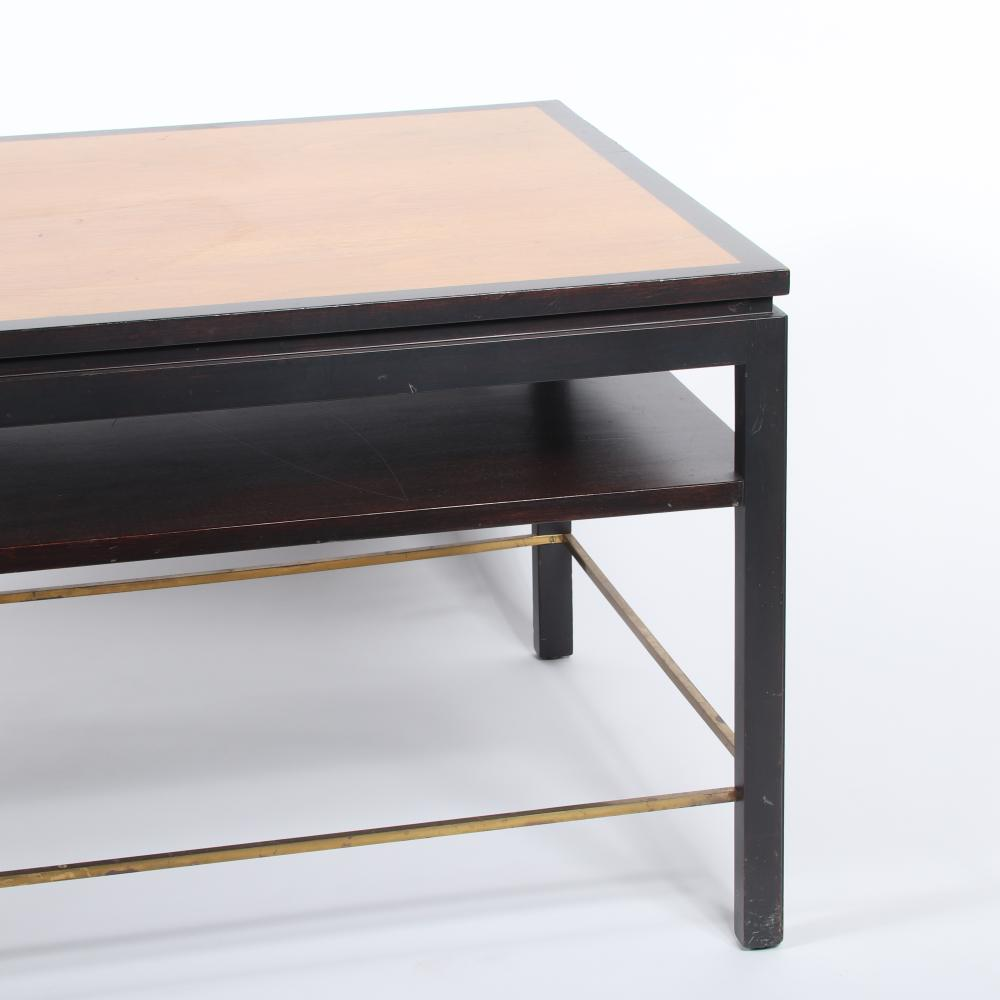 """Edward Wormley for Dunbar, mid-century modern coffee table, walnut, two toned wood table top, recessed base, with shelf tier and brass stretchers. 22""""H x 48""""W x 28"""" (depth)"""
