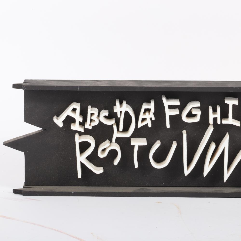 """James Spencer Russell, (New York / Indiana,1915-2000), alphabet wall sculpture, painted carved wood construction, 5 1/2""""H x 25""""W"""