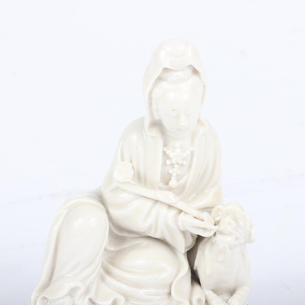 """Chinese Blanc de Chine figure of a woman holding a pipe on stand. 5 1/2""""H x 3 1/2""""W"""