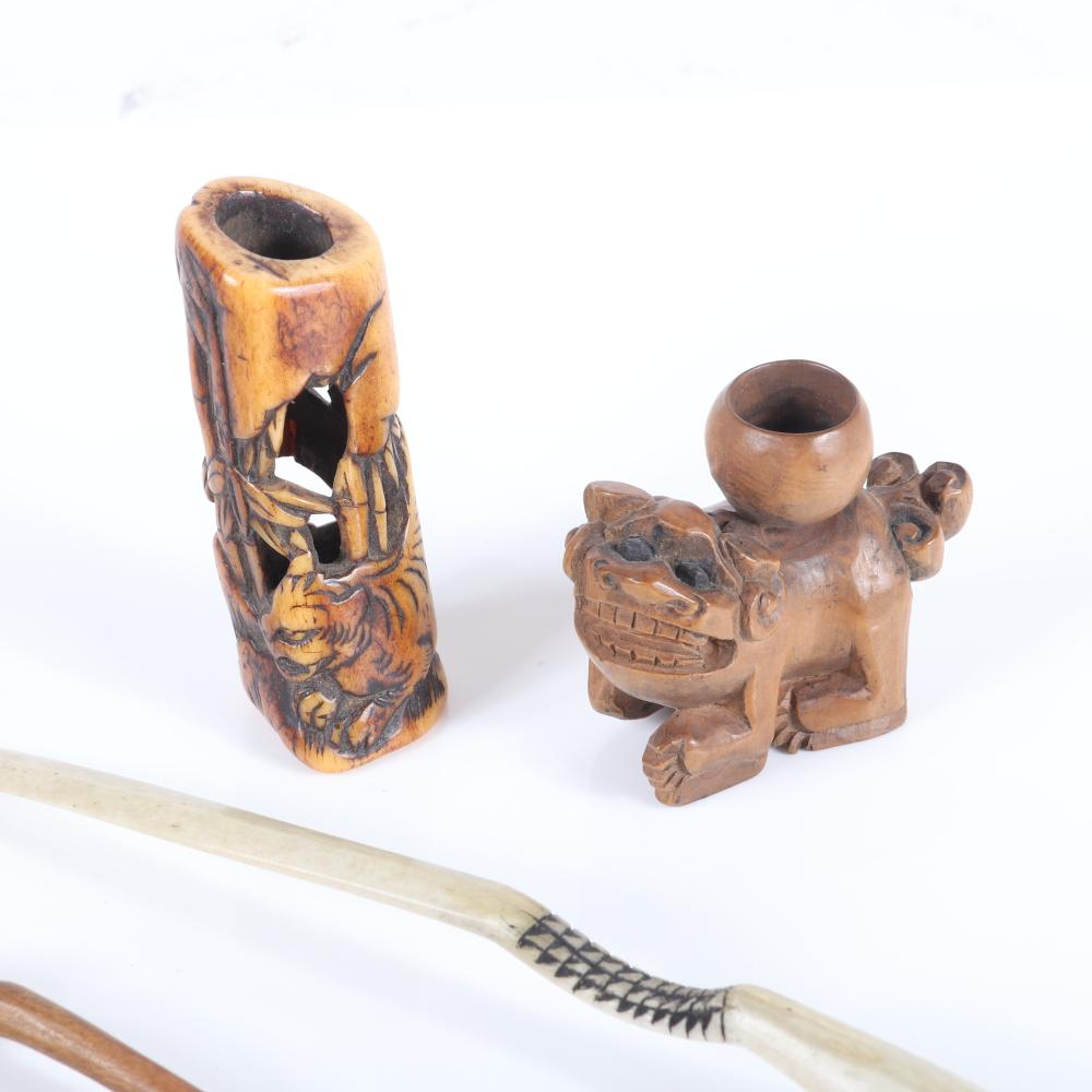 """Asian Antique grouping of folk art carvings including Japanese mythological and fossil bone carvings, boxwood netsuke, intricate ebony lotus base, boxwood hair pin, horn spoon. 5 1/2""""H x 1/4"""" W (one)"""