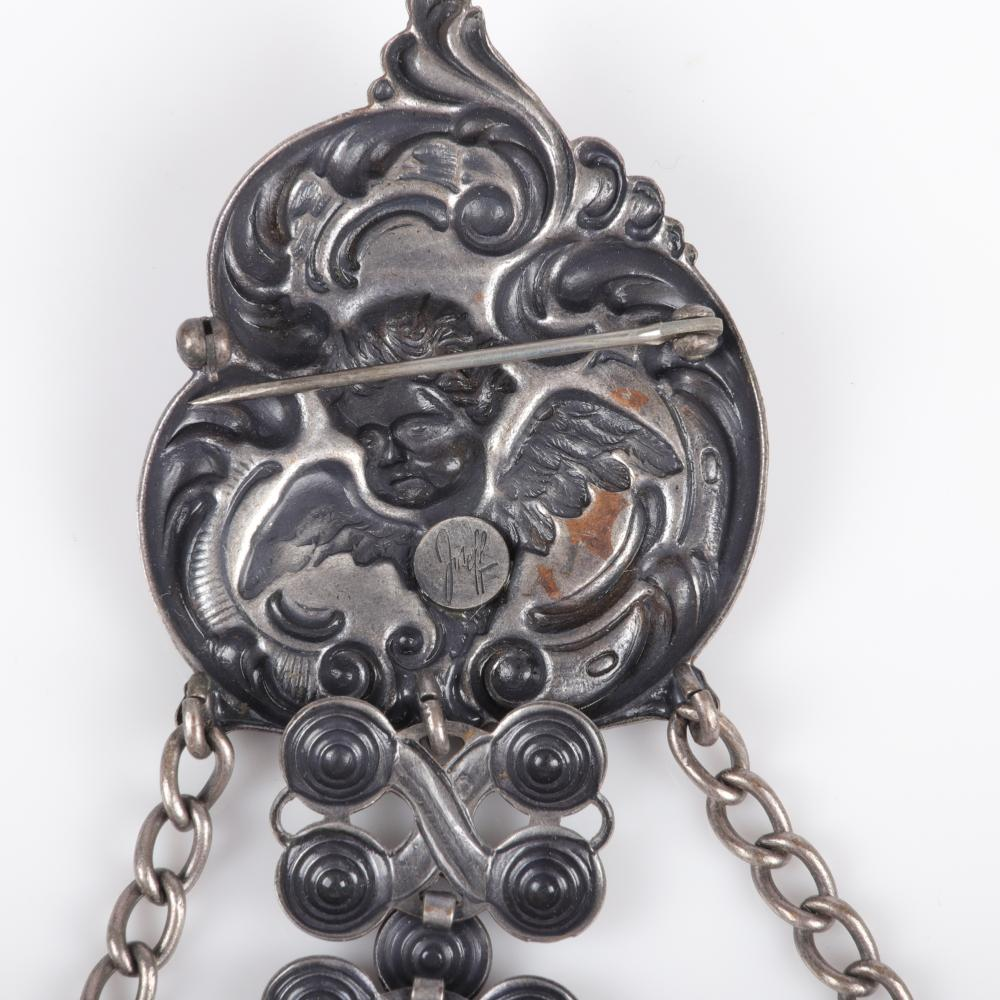 Joseff of Hollywood silver tone group repousse brooch with cherub and dangling heart, 7