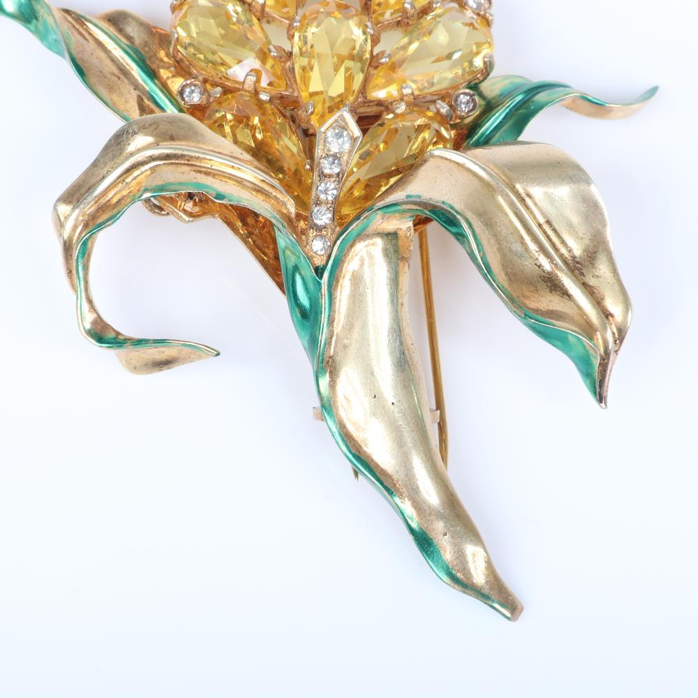 """Eisenberg Original Ruth Kamke's sterling vermeil orchid flower with bright citrine stones bezel and pave clear accents and green enamel, a personal favorite of the designer, 1943. 3 3/4"""" x 3 1/4"""""""