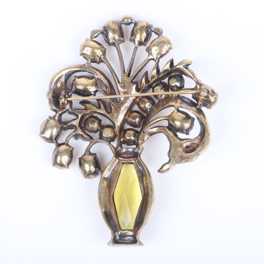 "Eisenberg Original sterling vermeil flowers and vase brooch with 1 1/4"" citrine crystal that forms the vase and topaz rhinestone flowers set with clear pave rhinestones, mid-1940s. 3 7/8"" x 2 3/4"""