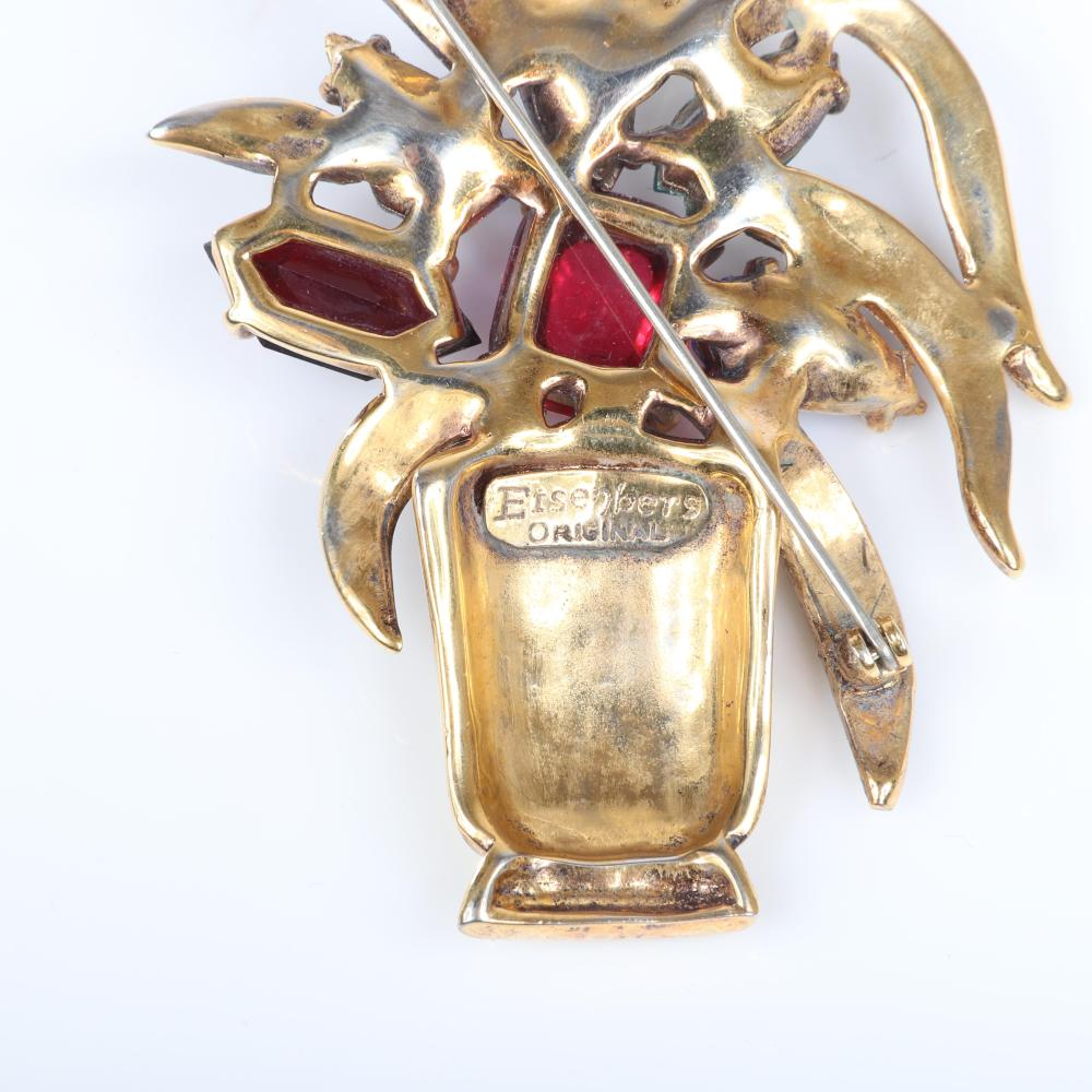 "Eisenberg Original agave plant in vase brooch in gold plated pot metal, with black and yellow enameling and various cuts of jewel tone crystals and center cabochon, c. 1940. 3 1/2"" x 2"""