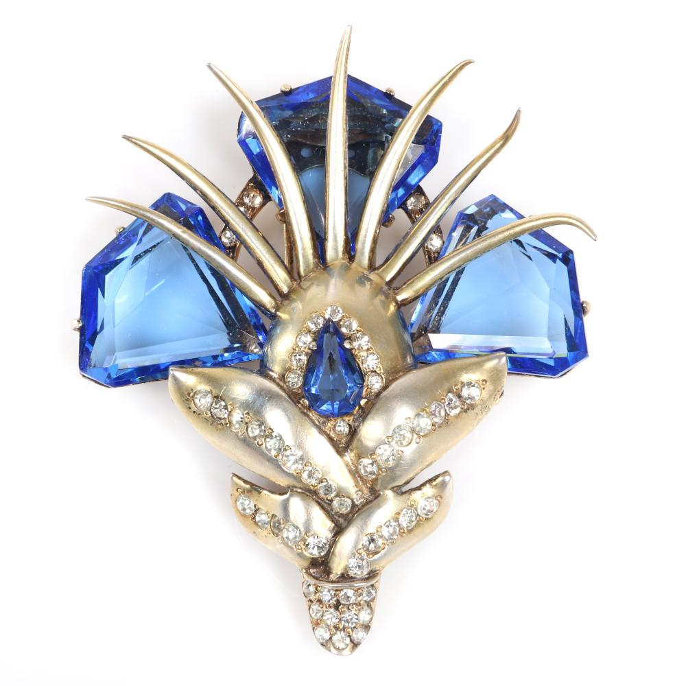 "Eisenberg original sterling vermeil abstract flower fur clip with three large blue diamond shaped crystal flowers, seven gold spikes and pave details, mid-1940s. 3 1/4"" x 2 3/4"""