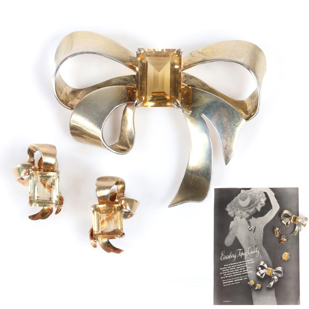 """Eisenberg Original Brazilian sterling vermeil topaz quartz rare bow pin incised #21 and ribbon screw back earrings, with original 1943 Vogue advertisement featuring the brooch. 2 7/8"""" x 2 1/3"""" (pin)"""