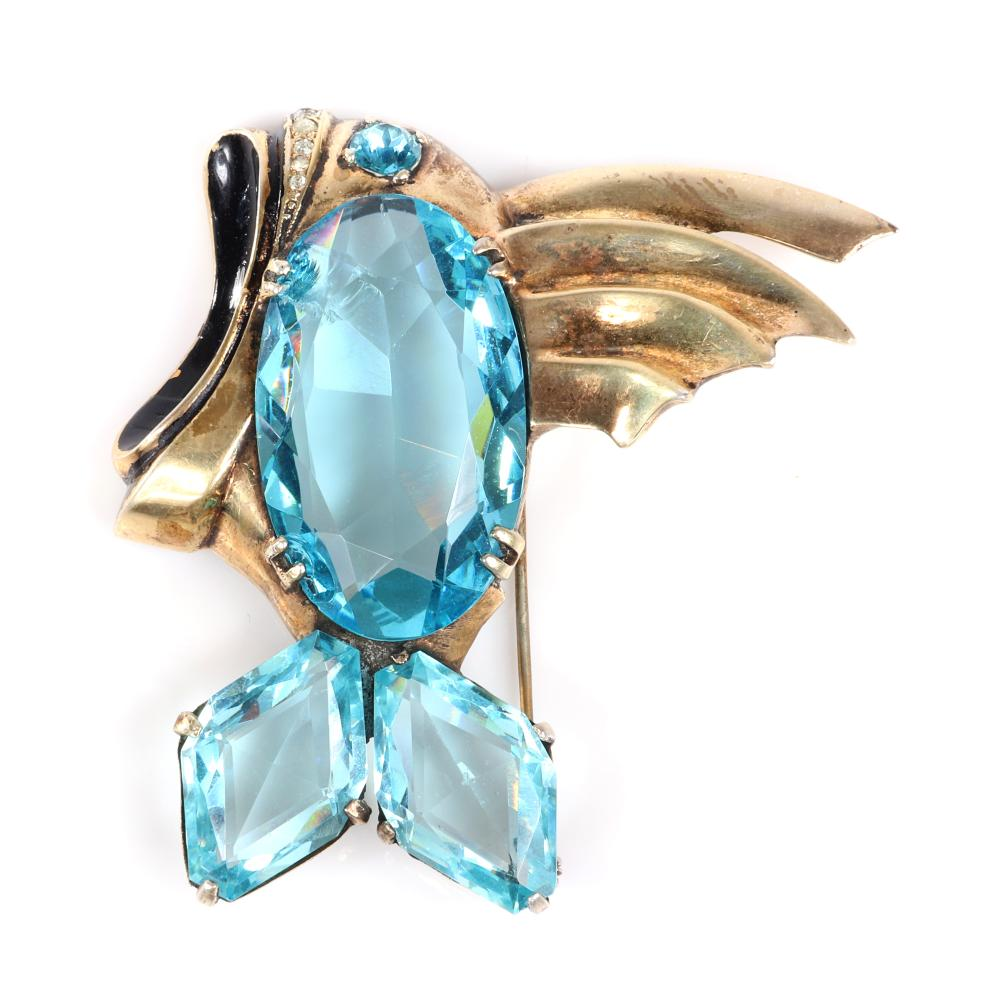 "Eisenberg Original gold plated figural fish brooch with huge faceted aqua crystal body and tail and black enamel and tiny rhinestones accenting the open mouth, c. 1940. 2 3/4"" x 3"""