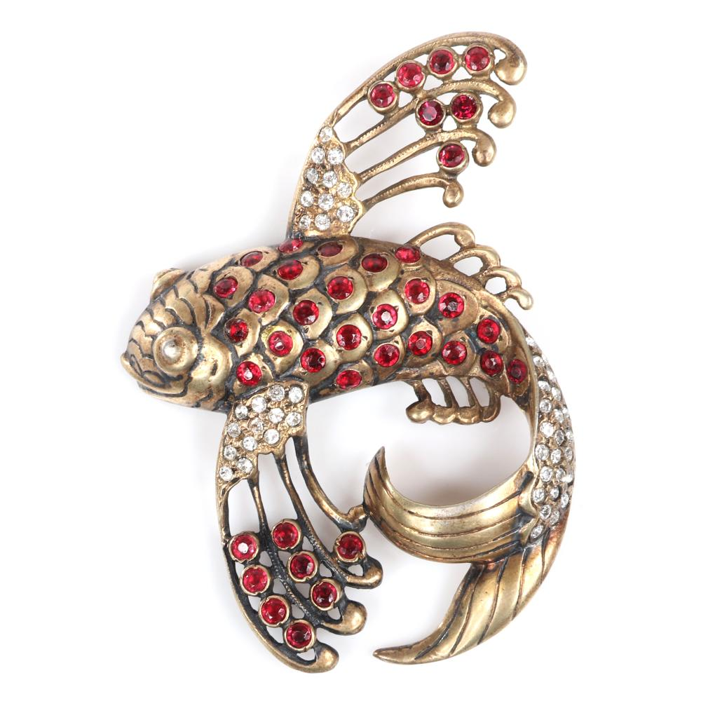 """Eisenberg Original sterling vermeil flying fish brooch with layered scales with hints of black enameling, accented with ruby rhinestones and pave details, mid-1940s. 3 1/4"""" x 2 1/2"""""""