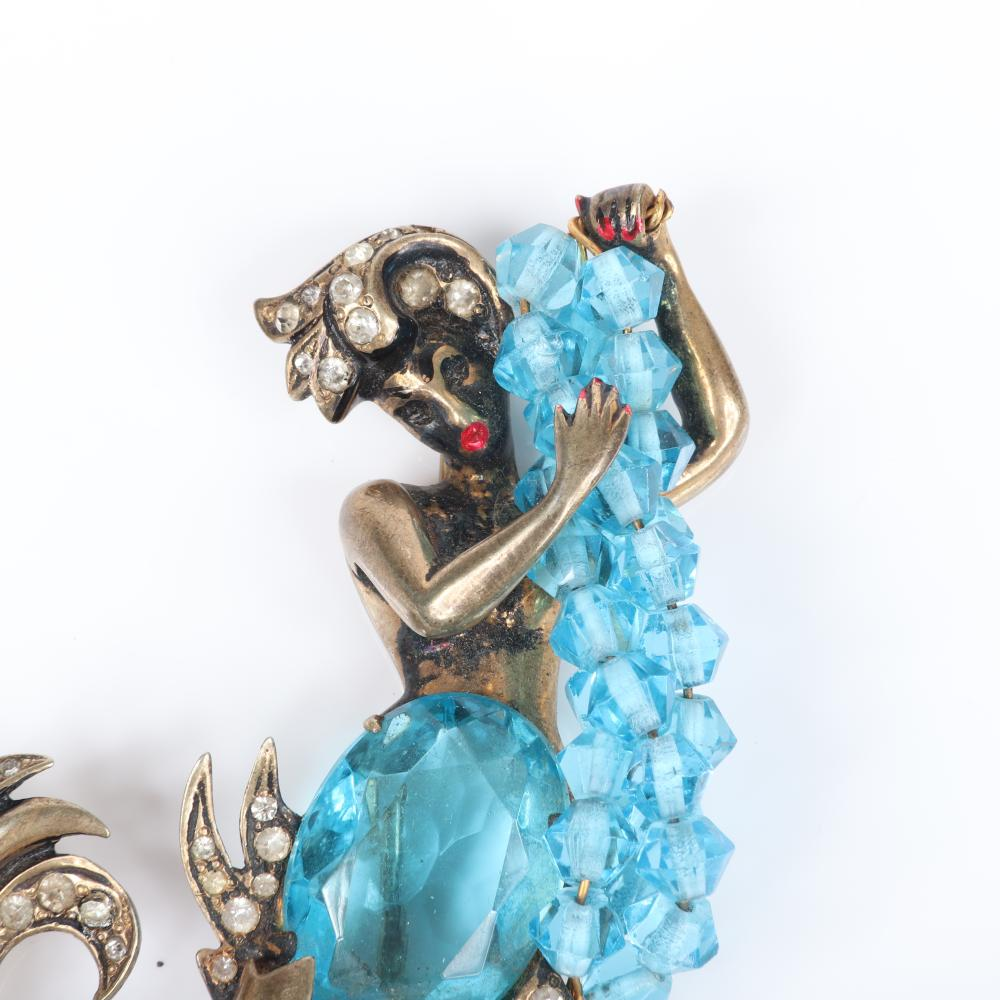 "Eisenberg Original iconic sterling vermeil mermaid brooch holding strands of aquamarine crystals, with faceted open-backed aquamarine crystal torso & red enamel lips, mid-1940s. 3 1/4"" x 2 3/4"""