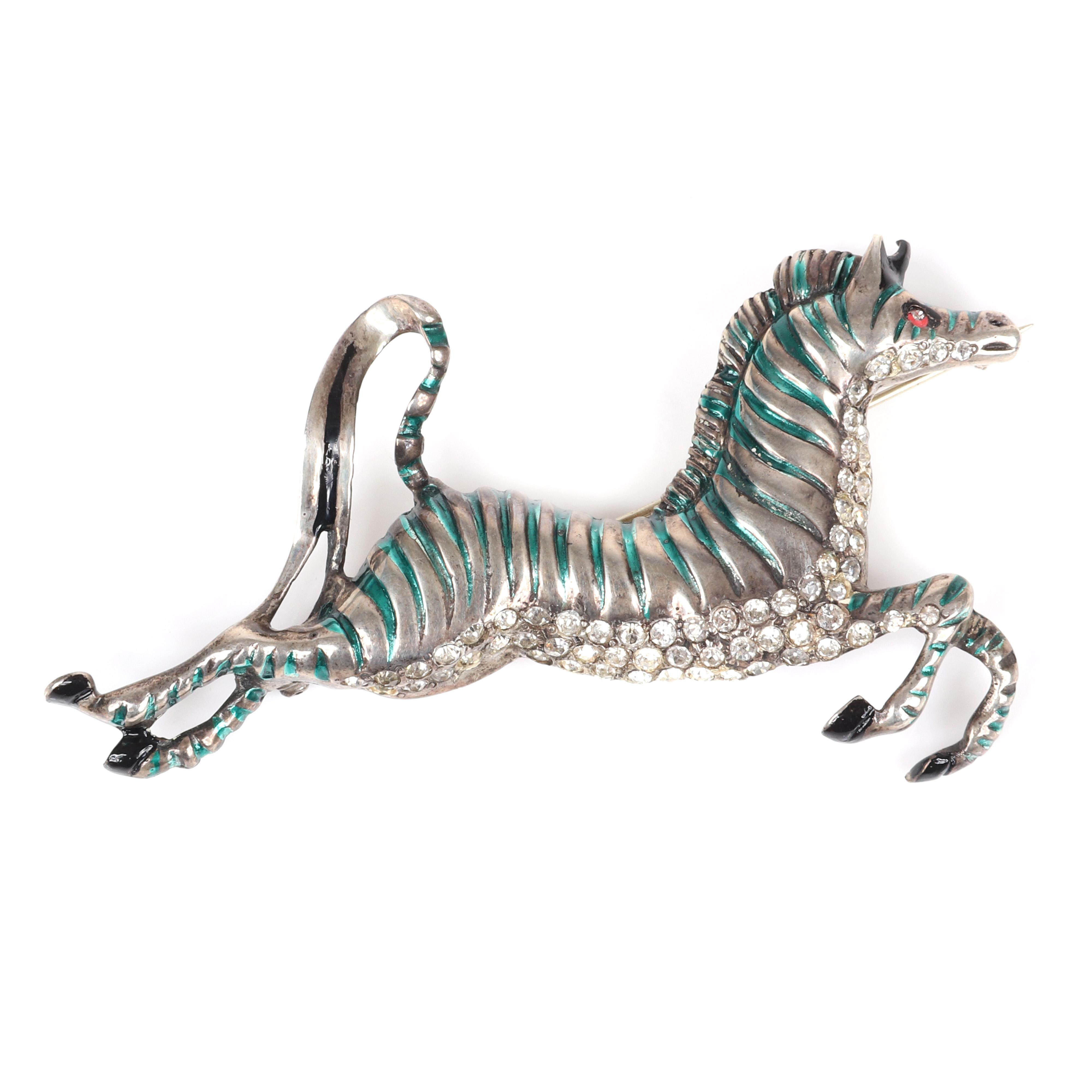 "Eisenberg Original figural prancing Zebra brooch with carved body, green enamel stripes, black enamel accents and clear rhinestones along the belly, mid-1940s. 2"" x 3 1/2"""
