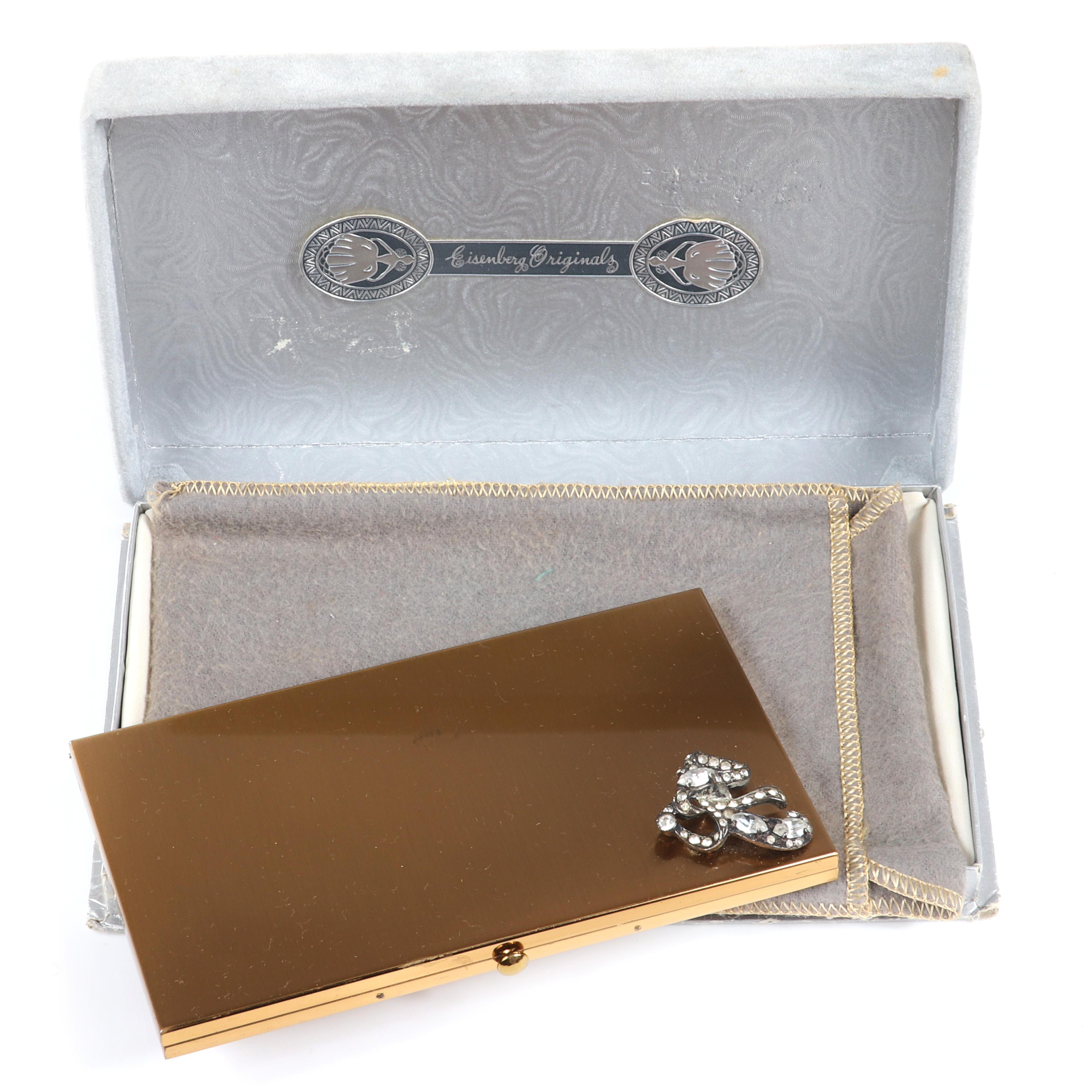 "Eisenberg Original gold tone cigarette case with silver pot metal and pave dimensional ribbon bow original box, felt liner and interior cigarette tray, c. 1940s. 3"" x 5 1/2"""