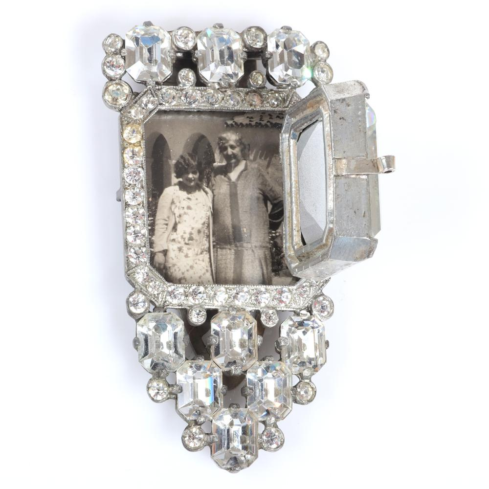 """Eisenberg Original Rare one of a kind prototype locket dress clip with huge square-cut central crystal, emerald-cut and bezel-set rhinestones, with original press photo. 3 1/4"""" x 1 3/4"""" (clip), 1 1/4"""" x 1 1/8"""" (large..."""