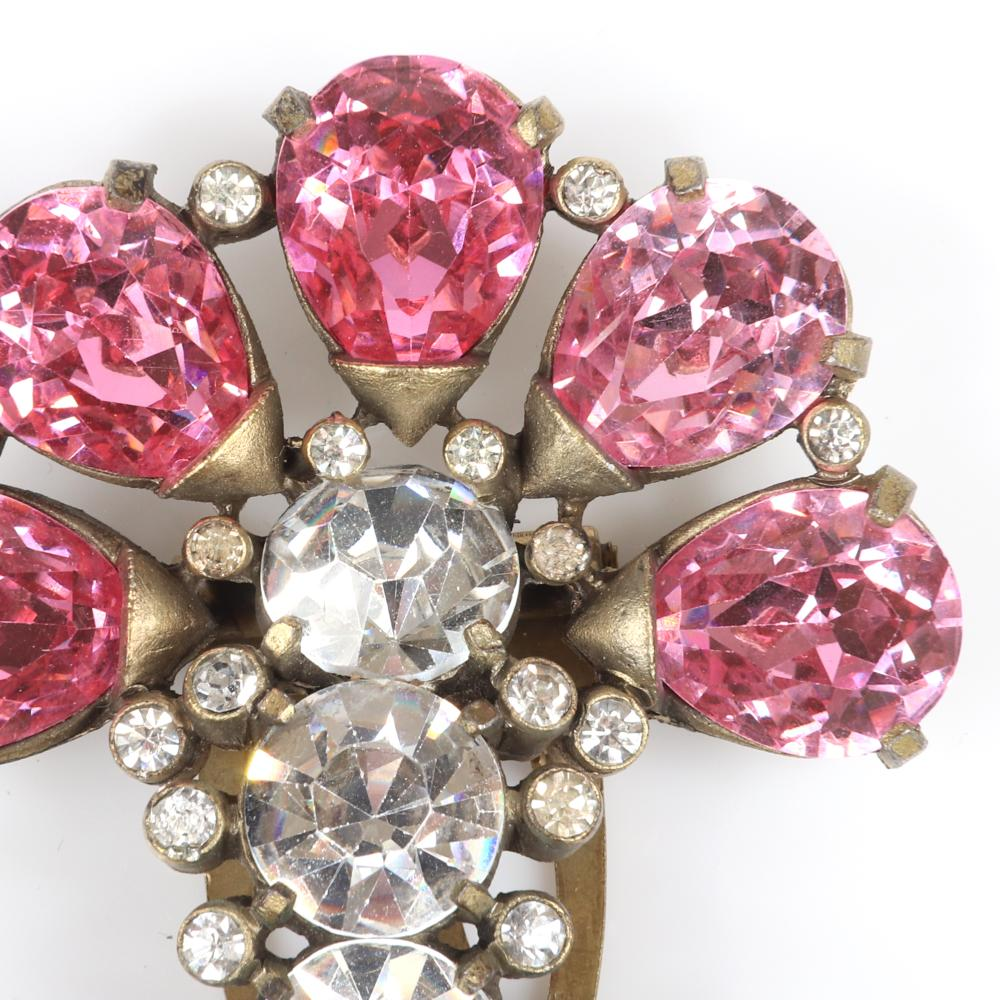 "Eisenberg Originals pair of gold-washed, stylized flower arching dress clip with five large pink crystal petals & stem with four large rhinestones surrounded by bezel-sets, c. 1940s. 2 1/2"" x 2"""