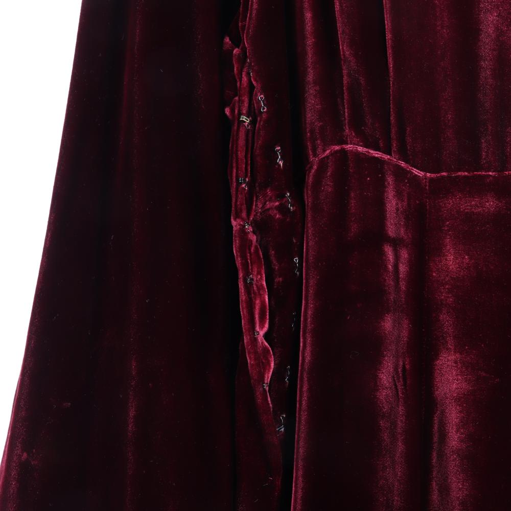 "Eisenberg Originals burgundy silk velvet long dress labeled with the earliest Eisenberg & Sons original label design, sleeves end in dramatic poufs, designed by Irma Kirby, 1930s. 50"" long; 17"" bust; 15"" waist; 14 1/2..."