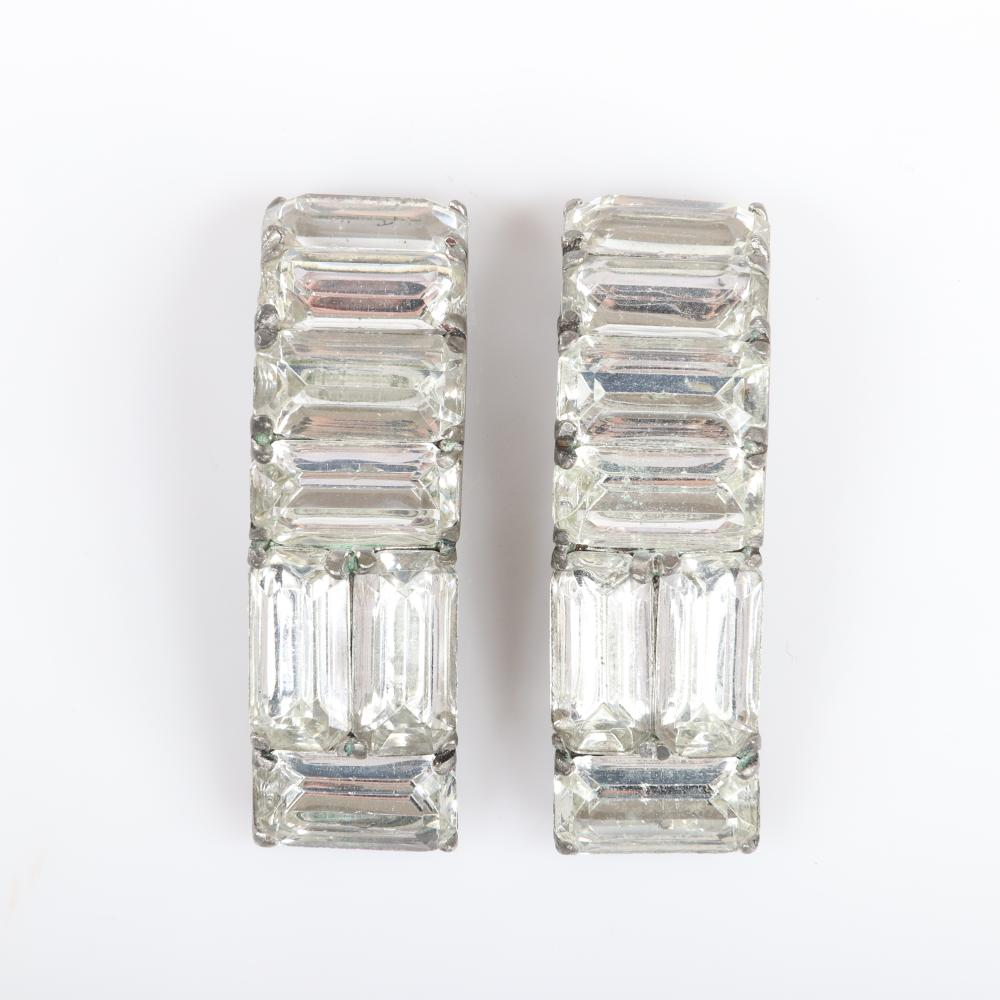 "Eisenberg Original pair of sew-on clips with large alternating rows of faceted rhinestone baguettes designed to be sewn on to a garment, c. 1940. 1 1/2"" x 5/8"""