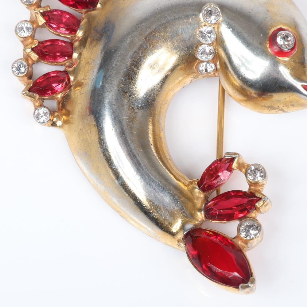 """Eisenberg Original fish fur clip with gold plate over pot metal body with top and tail fins made from ruby marquise crystals outlined with clear bezel-set stones, 1942. 2 3/4"""" x 2 1/3"""""""