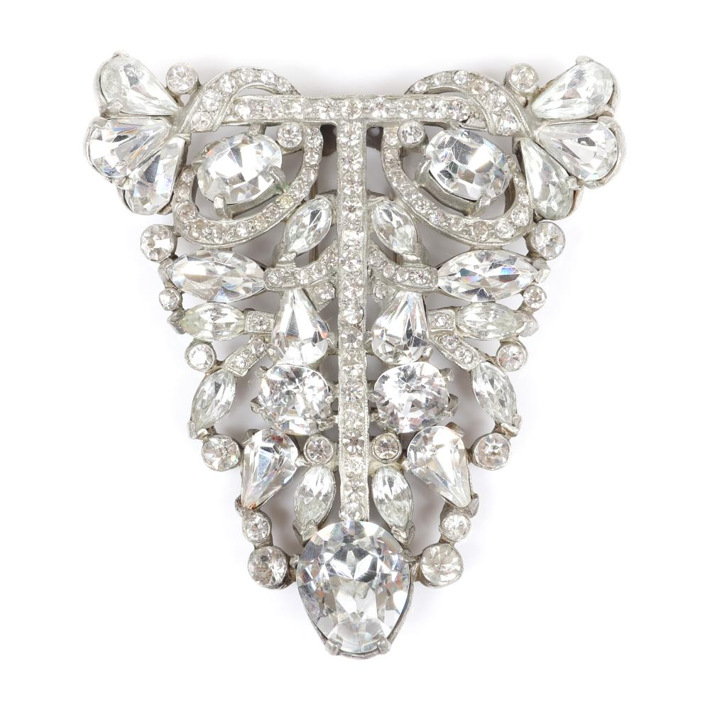 "Eisenberg Original abstract triangular fur clip in silver pot metal with large faceted pear, marquise, round and oval crystals and rows of clear pave, 1940. 3 1/8"" x 3 3/4"""