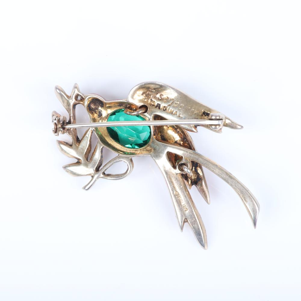 "Eisenberg Original sterling vermeil bird on branch pin with enameled feathers, large emerald crystal jewel belly and stem and pave-set rhinestones, 1943-44. 1 1/4"" x 2 1/4"""